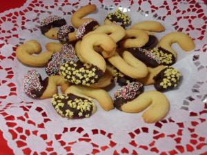 Weihnachtsbäcker:Spritzgebäck mit Schokolade und Zuckerdeko