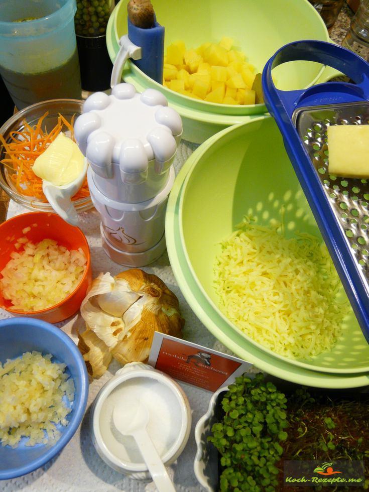 Zutaten:Butter, Rapsöl, Räucher-Knoblauch, Safranfäden, Kartoffeln, Zwiebeln, Möhren, Genüsebrühe, Käse,