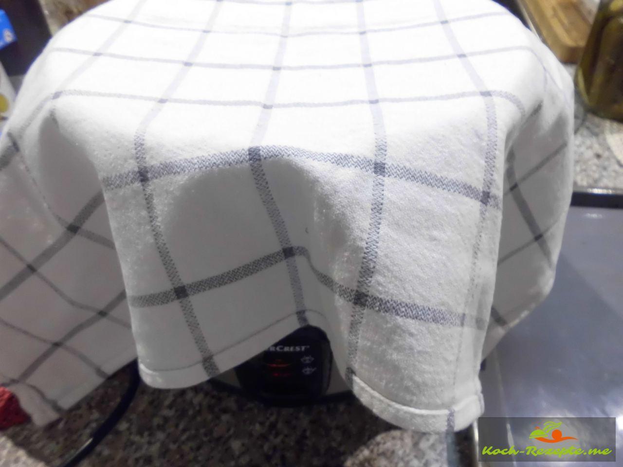 für 30 Minuten mit einem Handtuch abdecken