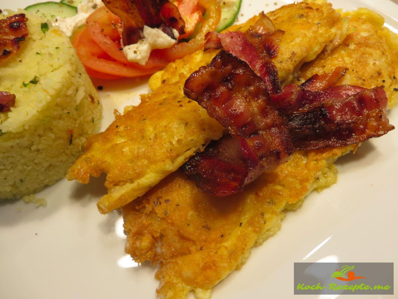 Plattfisch Pecorino Ei Panade mit Vegetable Couscous und Bacon.